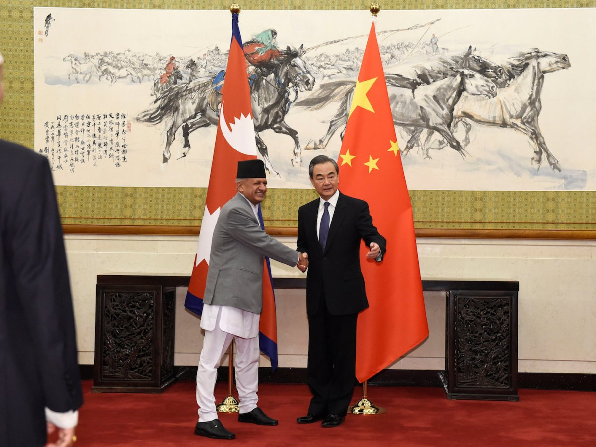 Nepalese Foreign Minister Pradeep Kumar Gyawali, left, shakes hands with Chinese Foreign Minister and State Counselor Wang Yi as they pose for media before their meeting on April 18, 2018, at the Diaoyutai State Guesthouse in Beijing. Photo: Reuters via Parker Song/Pool