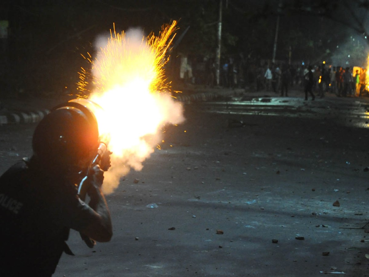 Police fire teargas shells at students from Dhaka University protesting against the quota for government jobs. Scores were injured. Photo: Nabiullah Nabi