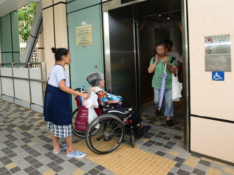 An elderly citizen enters a lift at a public housing estate in Hong Kong. Photo: Google Maps