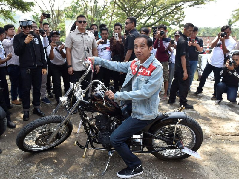 Indonesian President Joko Widodo poses with a Royal Enfield motorbike during his visit at Pelabuhan Ratu beach in Sukabumi, Indonesia,  April 8, 2018.  Photo: Antara Foto/Puspa Perwitasari via Reuters
