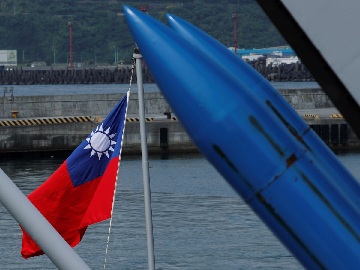 A Taiwanese flag is seen behind standard Type II missiles on the destroyer Kee Lung during a drill near Yilan naval base, Taiwan, on April 13, 2018. Photo: Reuters / Tyrone Siu