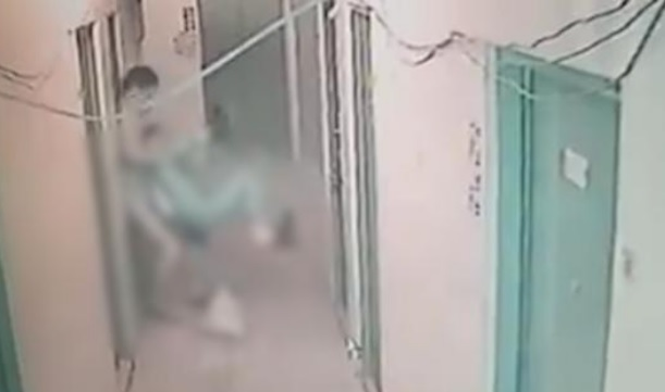 A man was seen forcing a woman into his room in a 30-second clip. Photo: screen grab