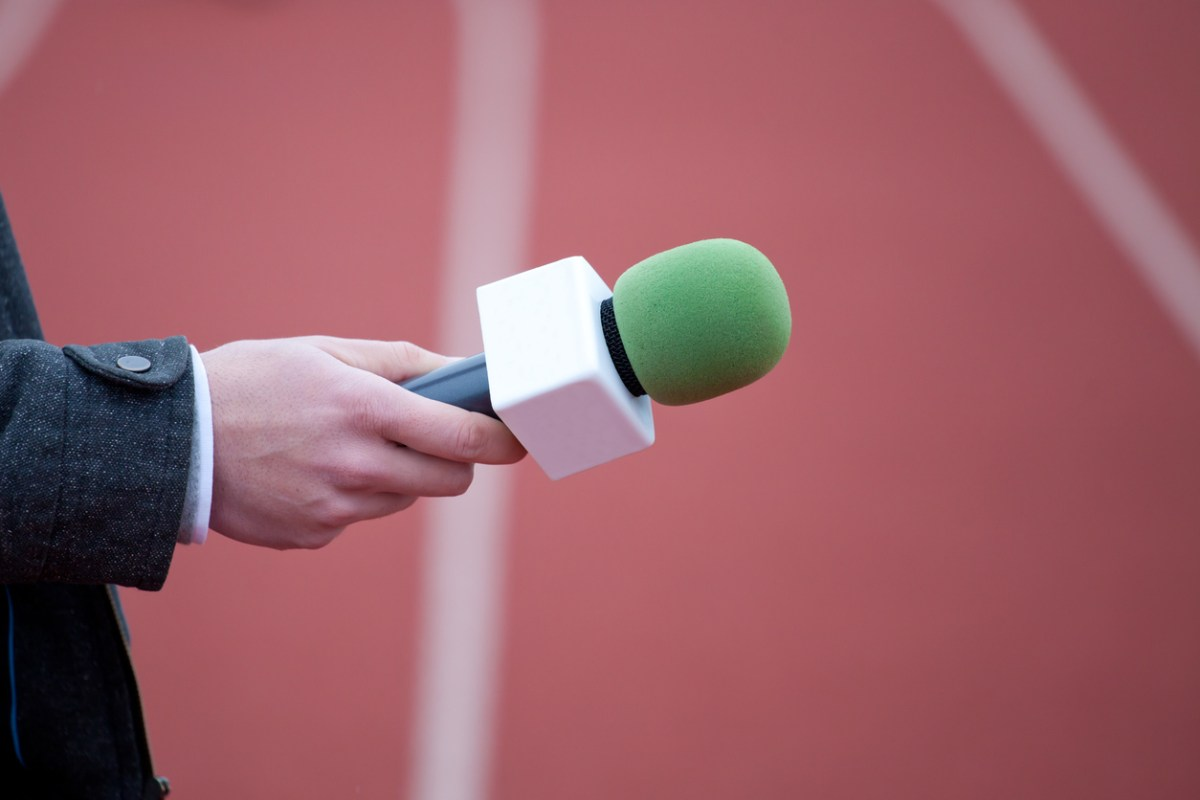 reporter holding microphone for interview. Photo: iStock