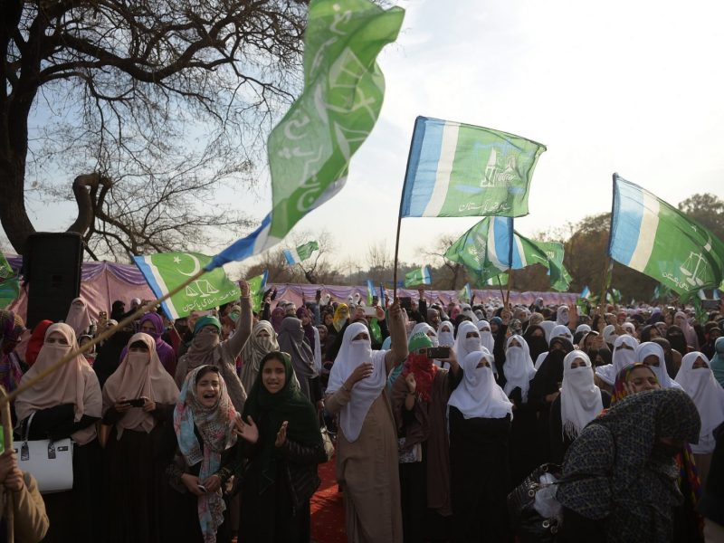 Activists of Jamaat-e-Islami Pakistan wave party flags as they gather to mark Kashmir Solidarity Day in Islamabad. Photo: AFP / Aamir Qureshi