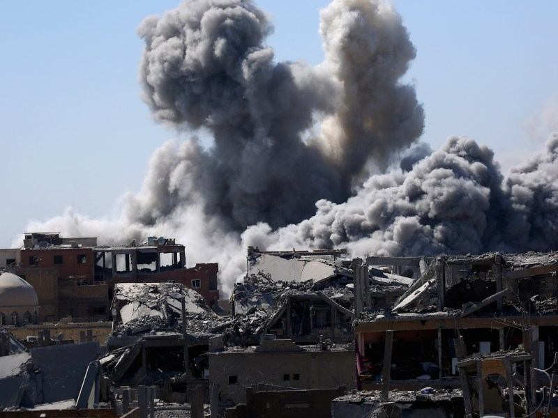 Smoke billows over the embattled northern Syrian city of Raqa in September. The seven-year-old civil war continues with no end in sight. The author argues that China should play a greater role in helping to end conflicts throughout the Middle East. Photo: AFP/Delil Souleiman