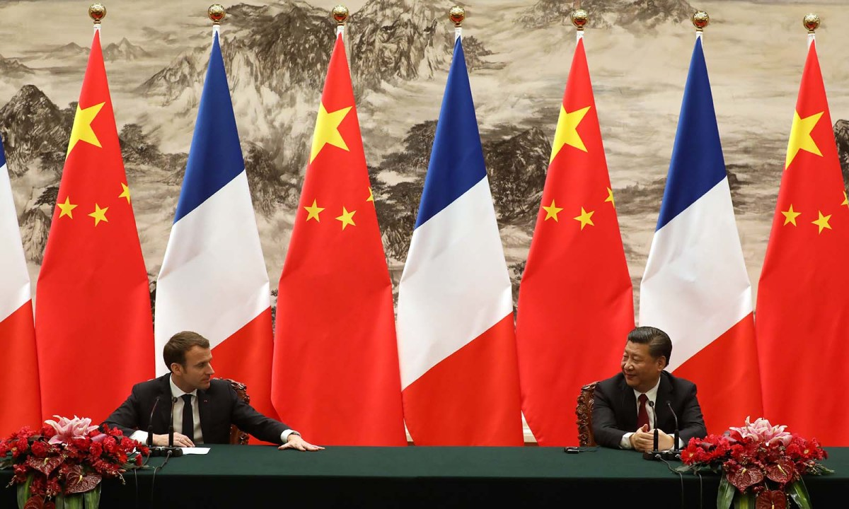 French President Emmanuel Macron (L) and Chinese President Xi Jinping attend a press conference in Beijing on January 9, 2018. Photo: AFP/Ludovic Marin