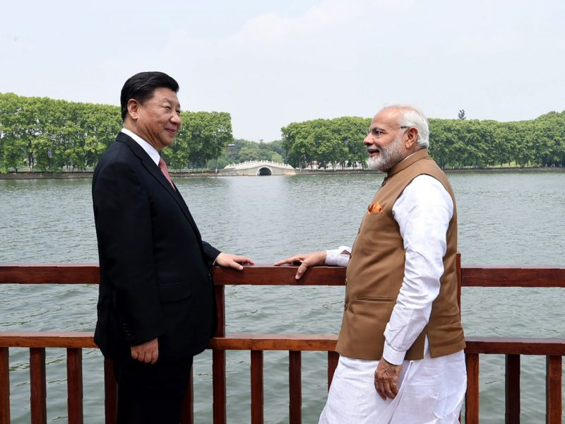 Indian Prime Minister Narendra Modi, right, and Chinese President Xi Jinping look out over East Lake in Wuhan in this photo taken on April 28, 2018. Their talk aimed to reduce border tensions but it appears to have had limited effect. Photo: AFP/ govt handout