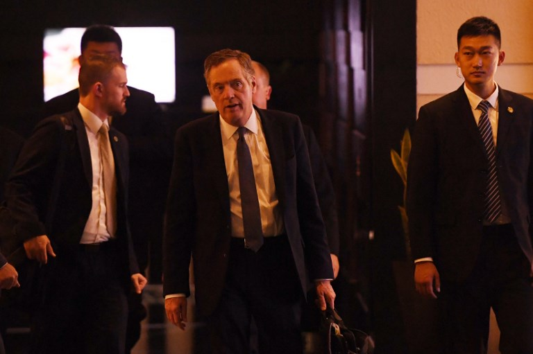 US Trade Representative Robert Lighthizer walks through a hotel lobby in Beijing on Wednesday as he and other Trump administration officials prepare to kick of trade talks. Photo: AFP