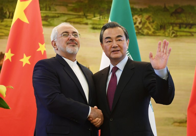 Iran's Foreign Minister Mohammad Javad Zarif shakes hands with his Chinese counterpart Wang Yi after a joint press conference in Beijing. Photo: AFP/Greg Baker