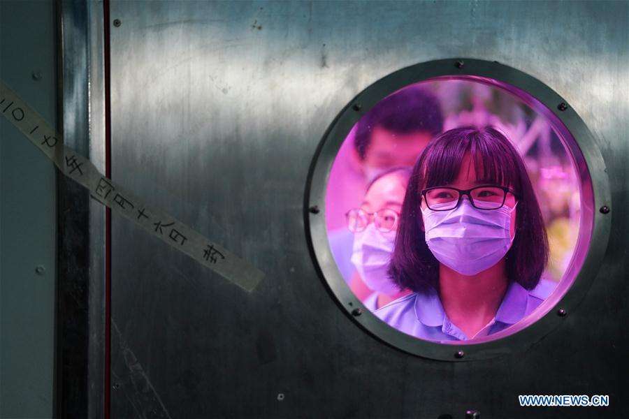 A photo taken in May 2017 shows a volunteer inside the lab. Photo: Xinhua