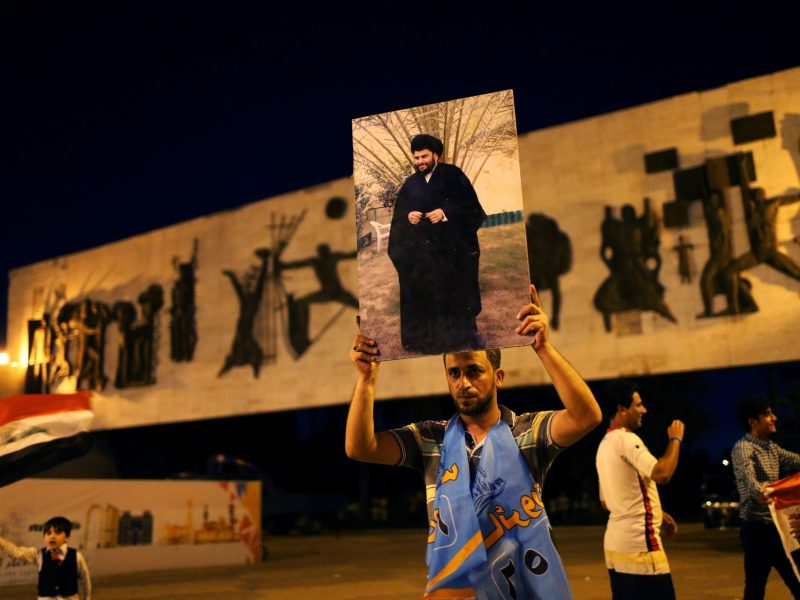 An Iraqi supporter of the Sairun list celebrates with portraits of Shiite cleric Muqtada al-Sadr, after results of Iraq's parliamentary election were announced in Baghdad on May 14, 2018. Photo: Reuters/Thaier al-Sudani