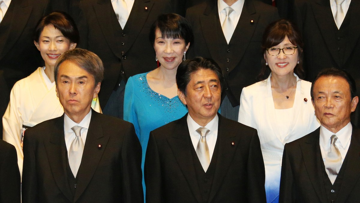 Prime Minister Shinzo Abe (front, C) and his cabinet members pose for a photo at his office in Tokyo on Aug 3, 2016. His Cabinet had three women at that time but now has just two. His latest efforts to promote gender parity have also been timid. Photo: AFP/ Yomiuri Shimbun