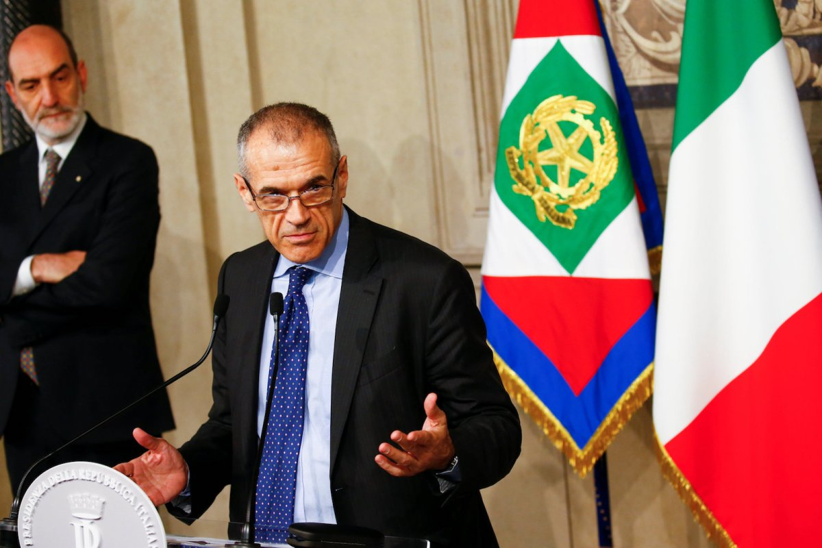 Former IMF economist Carlo Cottarelli speaks to the media after being asked by Italy's President Sergio Mattarella to form a new government, after efforts by two populist parties to form a coalition collapsed. Photo: Reuters / Tony Gentile