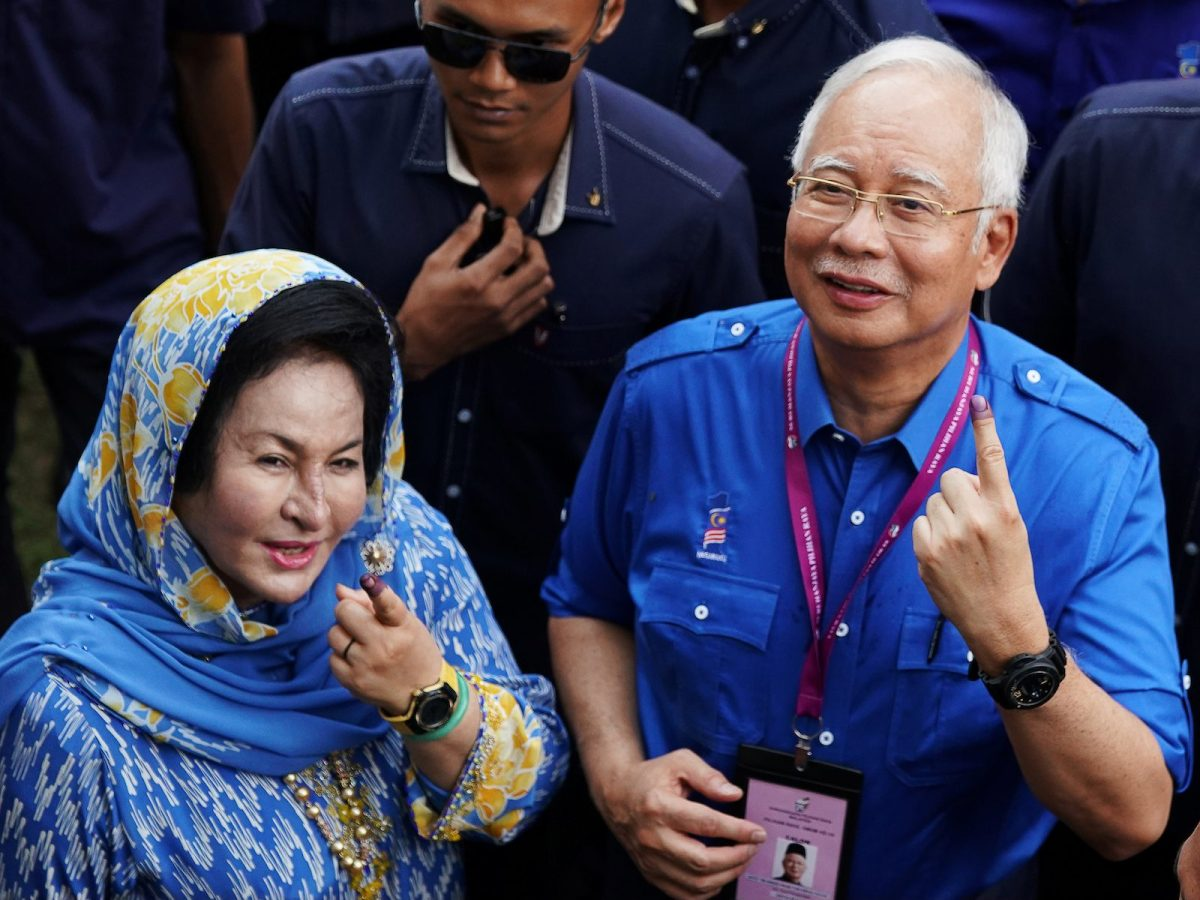 Former Malaysian PM Najib Razak, seen here with his wife Rosmah Mansor, has been accused of pilfering a vast sum from the 1MDB development fund before his shock poll defeat in May. Photo: Reuters/ Athit Perawongmetha