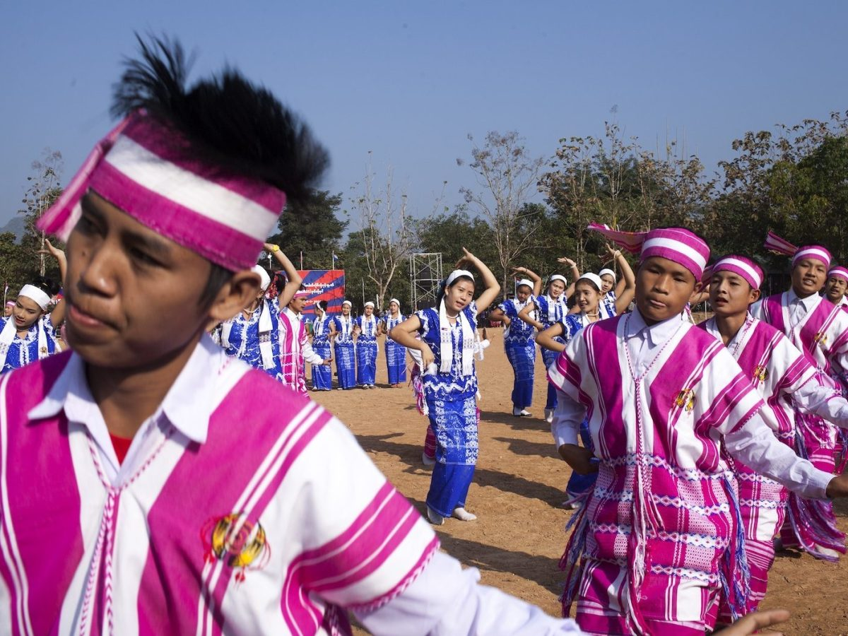 This picture taken on January 31, 2015 shows traditional Karen dancers perfoming for guests during celebrations marking the 66th Karen Revolution Day at the Karen National Liberation Army (KNLA)'s Seventh Brigade headquarters in Myanmar's eastern Kayin state. The KNLA is the armed wing of the Karen National Union (KNU) and is believed to have between 3,000 to 5,000 active fighters in its ranks. The KNU signed a ceasefire agreement with Myanmar's central government in 2012 but fighting has continued sporadically in several border areas, undermining the authorities' hopes to reach a nationwide ceasefire with all of the country's armed ethnic groups ahead of the 2015 general elections scheduled for the end of the year.  AFP PHOTO/KC Ortiz / AFP PHOTO / KC Ortiz