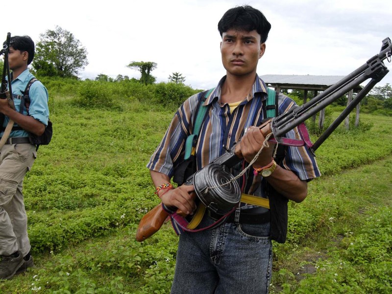 A cadre of the United Liberation Front of Asom (ULFA) stands guard at a camp near Amarpur in Tinsukia district, 600 kilometers from Guwahati, the capital city of India's northeastern state of Assam. Photo: AFP