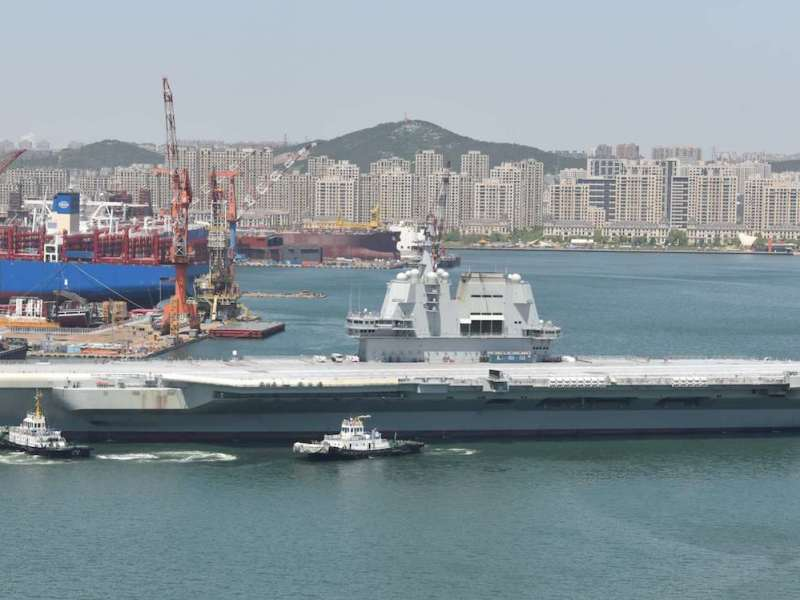 China's first domestically built aircraft carrier as seen at the Dalian Shipyard.  China already has one carrier, but Beijing believes the rising superpower must have more to safeguard not only its sovereignty, territorial integrity and national interests but also the region's, a view not shared by its neighbors.Photo: AFP / Wang Xizeng