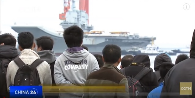 People gather near the Dalian Shipyard on May 13 to witness the start of the first homemade carrier's sea trial. Photo: CGTN screen grab