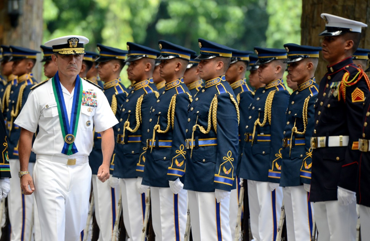 US Pacific Command chief Admiral Harry Harris, left, inspects an honor guard during an arrival ceremony at the Armed Forces of the Philippines headquarters in Manila in August 2015. Harris is set to be made US Ambassador to Seoul. Photo: AF / Noel Celis