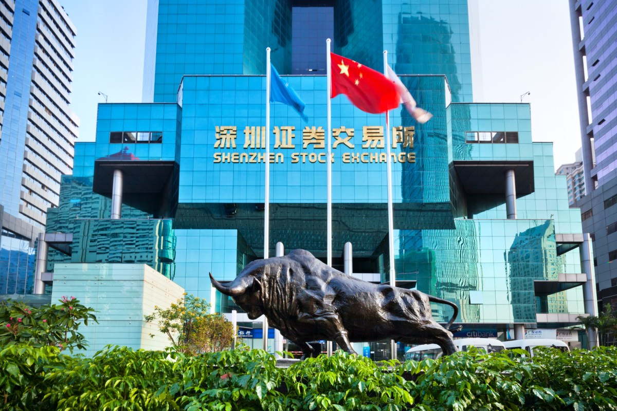 The bull sculpture and flags in front of the Building of Shenzhen Stock Exchange. Photo: iStock