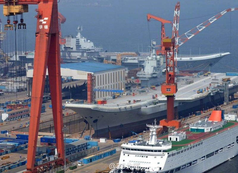 One port, two carriers: Liaoning and her sister carrier at the Dalian Shipyard earlier this week. Photo: Weibo