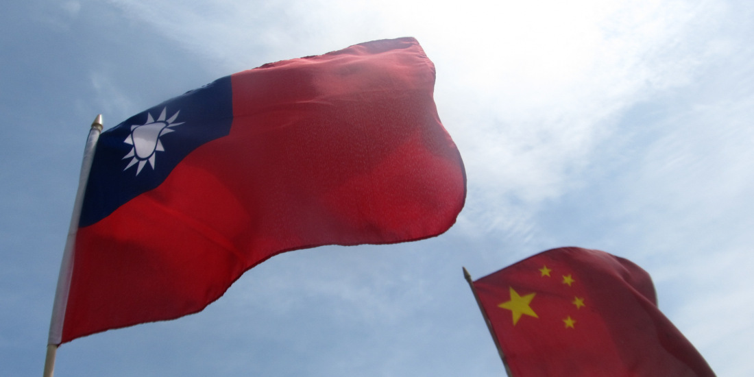 The Republic of China (Taiwan) flag, left, flies beside a People's Republic of China flag. Photo: Weibo