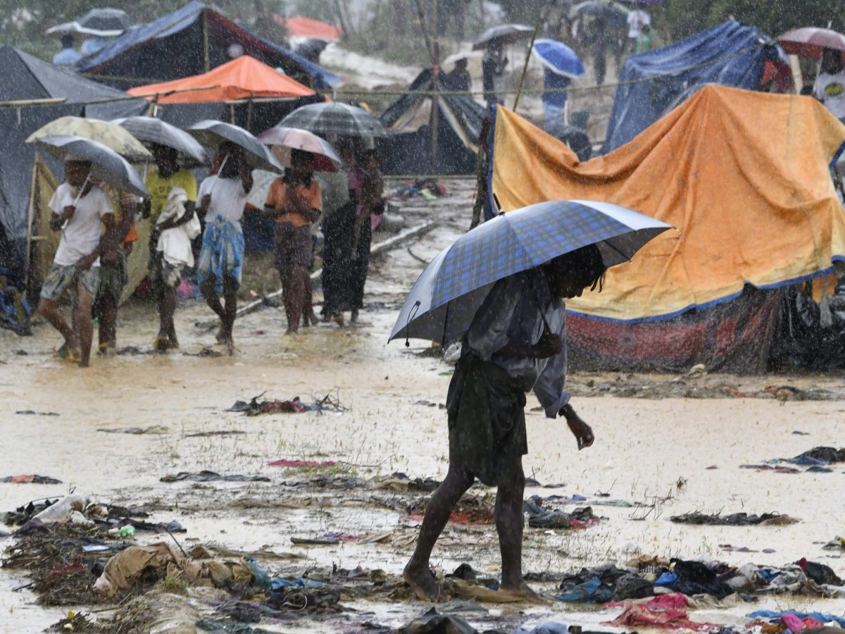 During monsoon rain in September 2017, a Rohingya walks through a refugee camp in Bangladesh. Photo: AFP/Dominique Faget