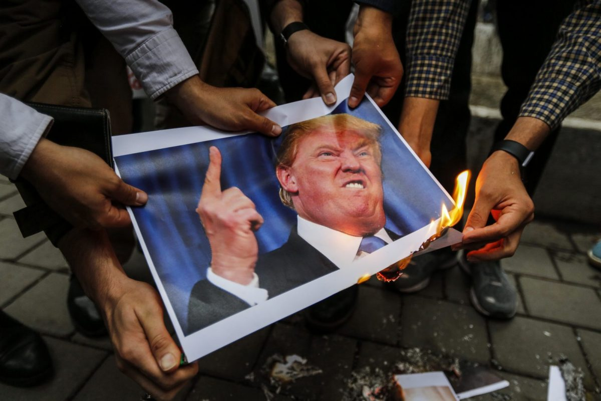 Iranians burn an image of US President Donald Trump during an anti-US demonstration outside the former US embassy headquarters in the capital Tehran on May 9, 2018. Photo: AFP/Atta Kenare