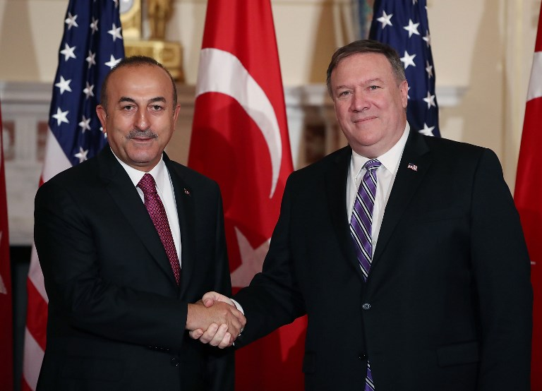 US Secretary of State Mike Pompeo greeting Turkish Foreign Minister Mevlut Cavusoglu on Monday. Photo: AFP