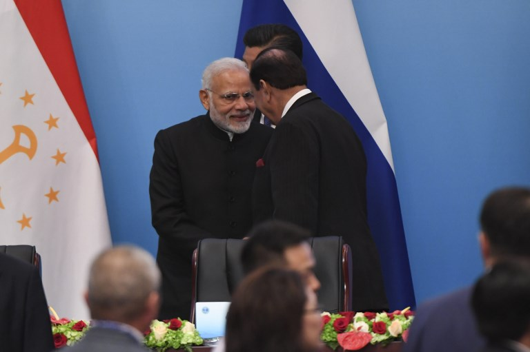 Indian Prime Minister Narendra Modi (left) talks with Pakistani President Mamnoon Hussain after a signing ceremony during the Shanghai Cooperation Organization Summit in Qingdao. Photo: AFP/Wang Zhao