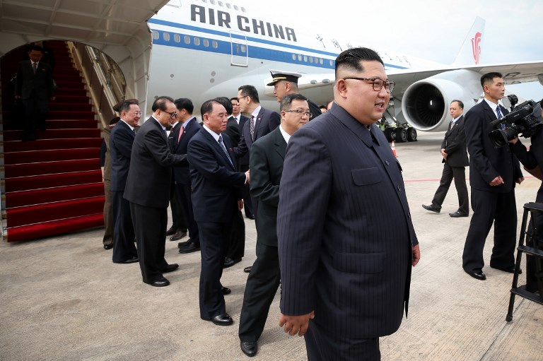 North Korean leader Kim Jong-un is seen in front of an Air China Boeing 747-400 jet when he arrived in Singapore on Sunday. Photo: AFP