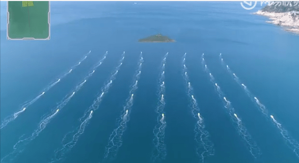 Unmanned boats in formation in waters off Zhuhai. Photo: People's Daily