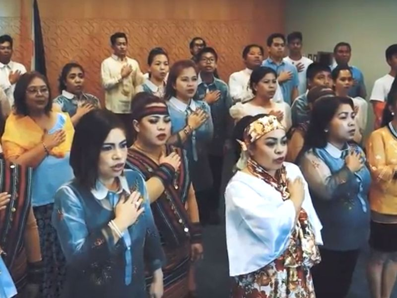 The Filipino community in the UAE singing the national anthem of the Philippines while dressed in traditional clothing. Photo: YouTube