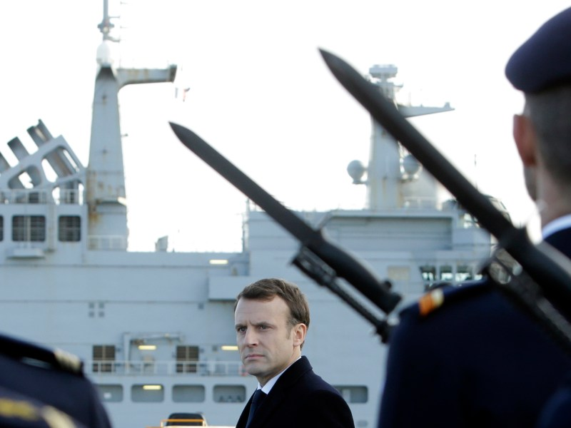 "French President Emmanuel Macron reviews an honor guard of the French Navy aboard the French Mistral Class assault ship and helicopter carrier ""Dixmude"", January 19, 2018. Photo: AFP/ Claude Paris"