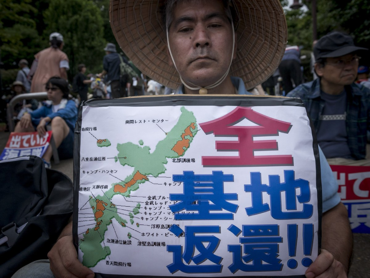 Anti-US airbase demonstrators protest the US Airbase relocation to Henoko in front of the Japanese Parliament in Tokyo, Japan on June 19, 2016. Photo: Nurphoto via AFP/Alessandro Di Ciommo