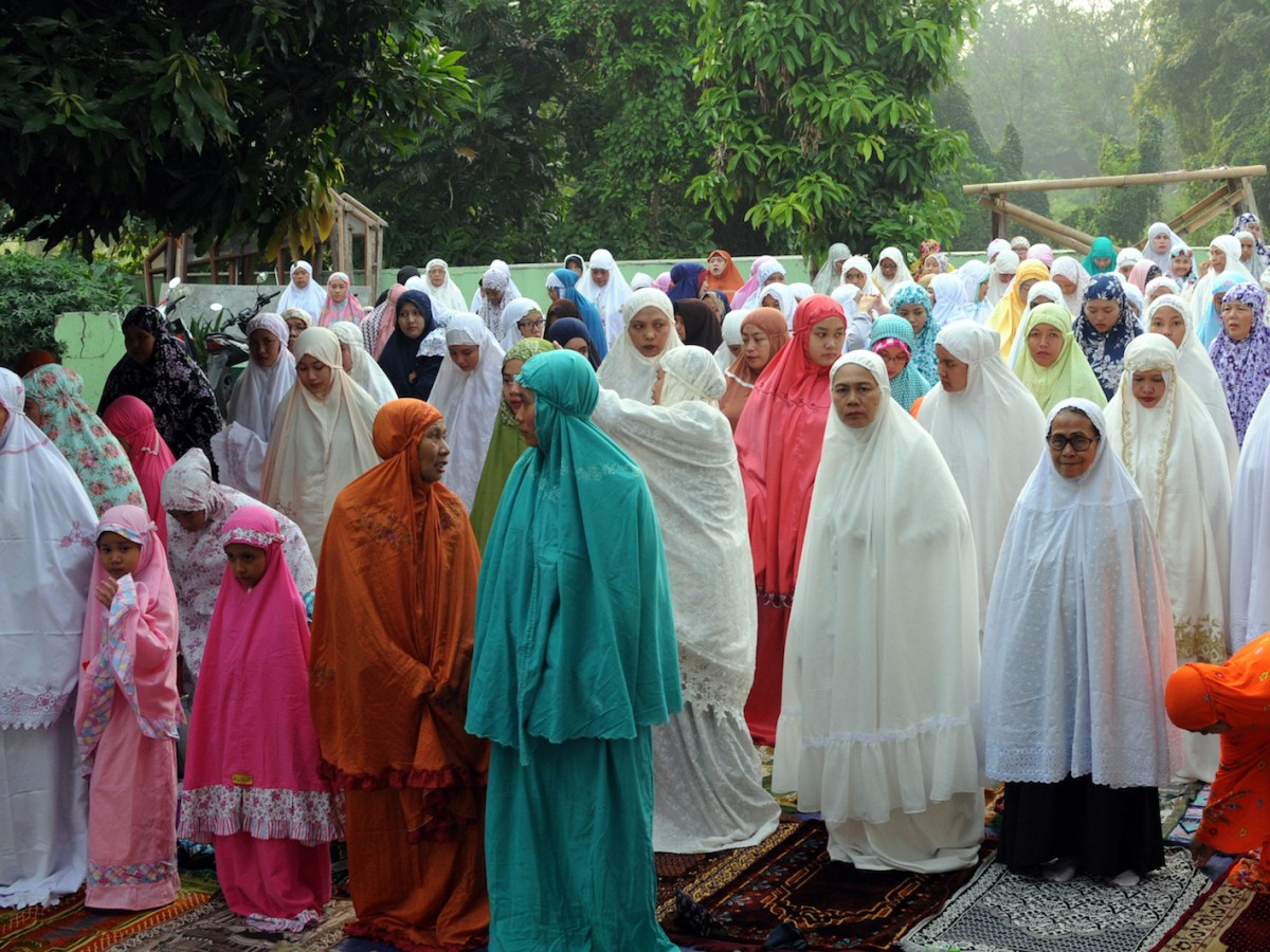 Indonesian Muslims take part in a morning prayer celebrating the Eid al-Fitr festival in Tangerang on June 15. The Widodo government is concerned about radicalization of youths and rising intolerance among young people. Photo: AFP/ Demy Sanjaya