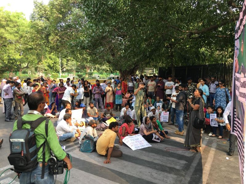 People gather in New Delhi, along with the IAPL, to protest against the arrest of five rights activists. Photo: Supplied