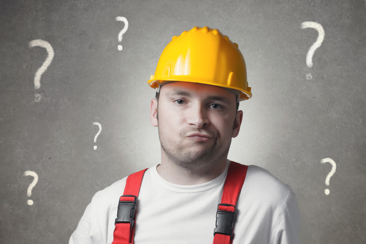 Confused young handyman with question marks. Photo: iStock