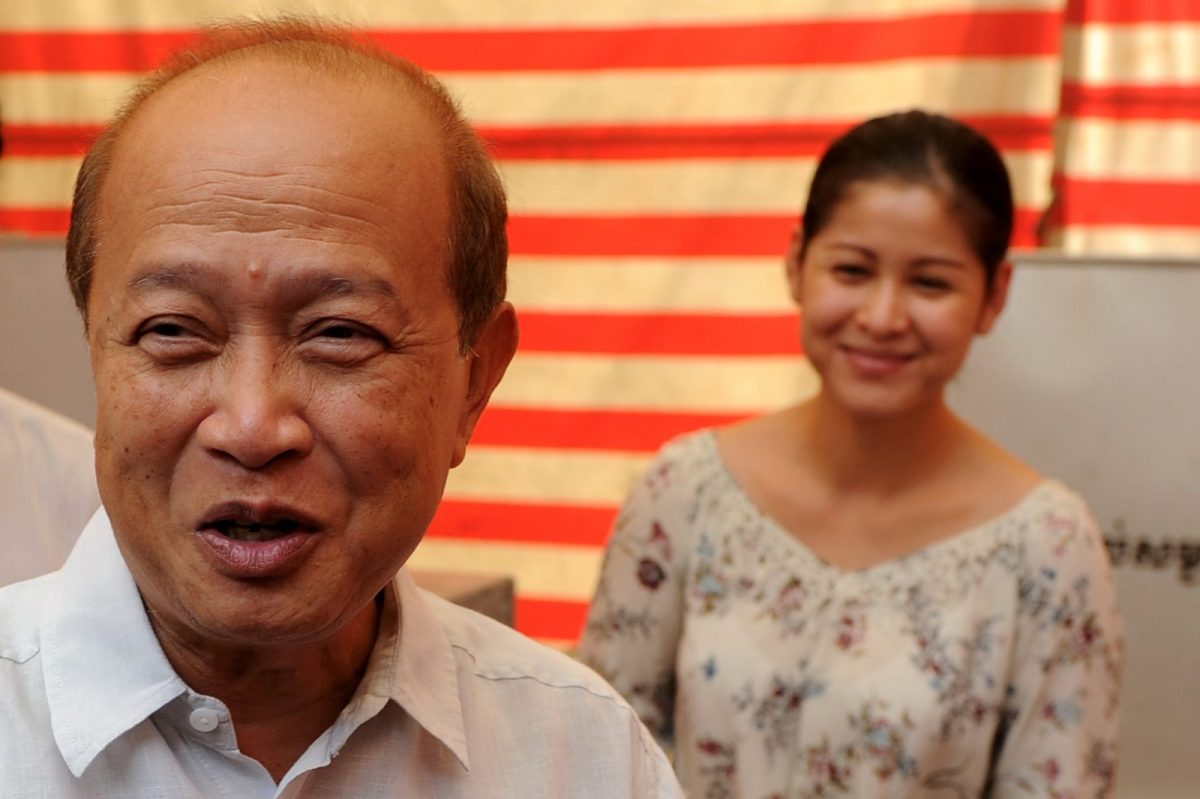Prince Norodom Ranariddh and his wife Ouk Phalla after casting their votes at a polling station in Phnom Penh June 3, 2012. Photo: AFP/Tang Chhin Sothy