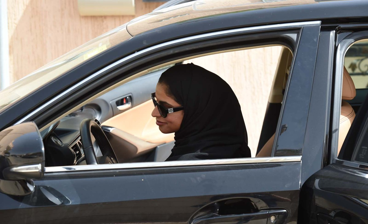 A chauffeur prepares to drive her car in Riyadh in June. More than a dozen Saudi activists who fought for her right to take the wheel were arrested in May, shortly before the decades-long ban on females driving in the kingdom was lifted. Photo: AFP
