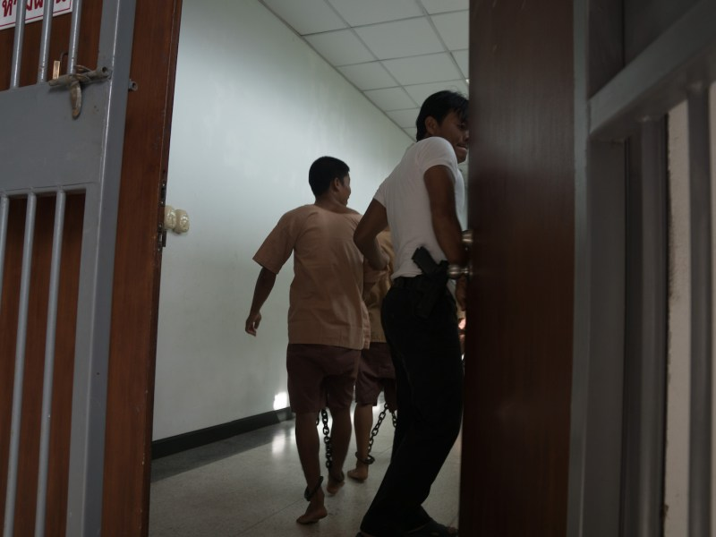 Shackles are seen around the ankles of prisoners at the back of a court in Thailand in July 2015. A man convicted of a brutal murder in Trang has been executed in Bangkok, the first use of the death penalty for nearly a decade. Photo: AFP/ Jerome Taylor