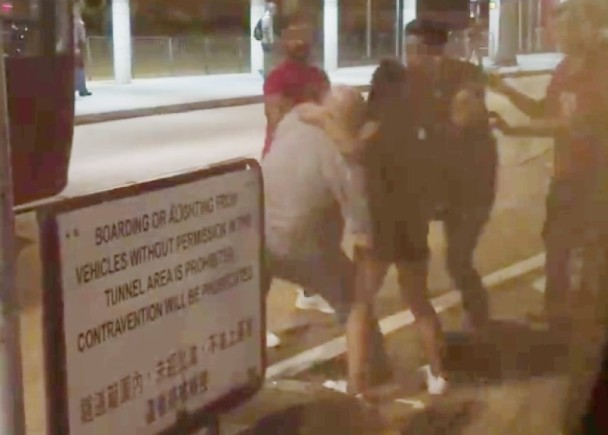 Three men were seen beating up a man near a bus stop in Kowloon on Tuesday morning. Photo: Facebook