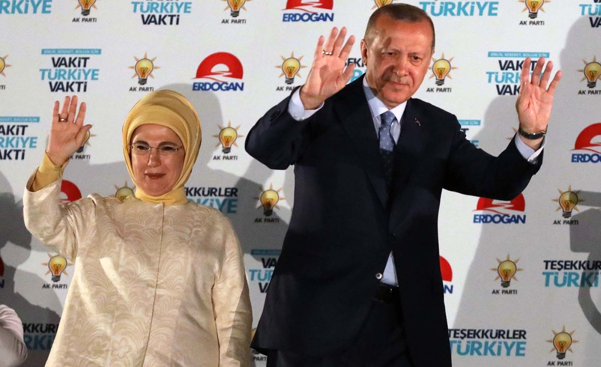 Turkish President Recep Tayyip Erdogan and his wife Emine Erdogan greet supporters at the AKP headquarters in Ankara on June 25, 2018. Photo: AFP/Adem Altan