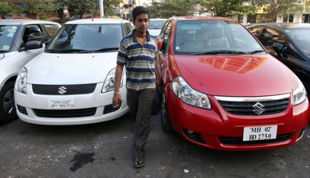 Maruti Suzuki cars at a parking lot in Mumbai: Photo: AFP