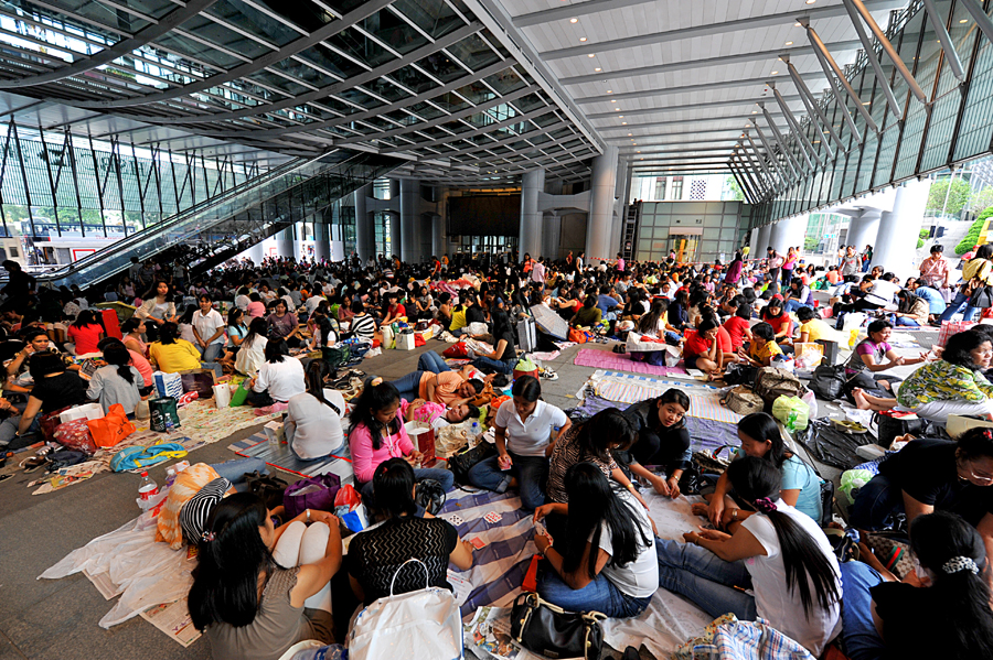 Foreign domestic helpers in Hong Kong  gather in the city's financial district on their day off work. The city has more than 370,000 of them. Photo: WordPress