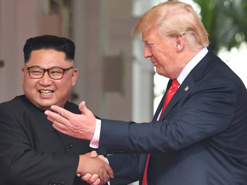 US President Donald Trump shakes hands with North Korea's leader Kim Jong Un at the start of their historic US-North Korea summit in Singapore on June 12. Photo: AFP/Saul Loeb