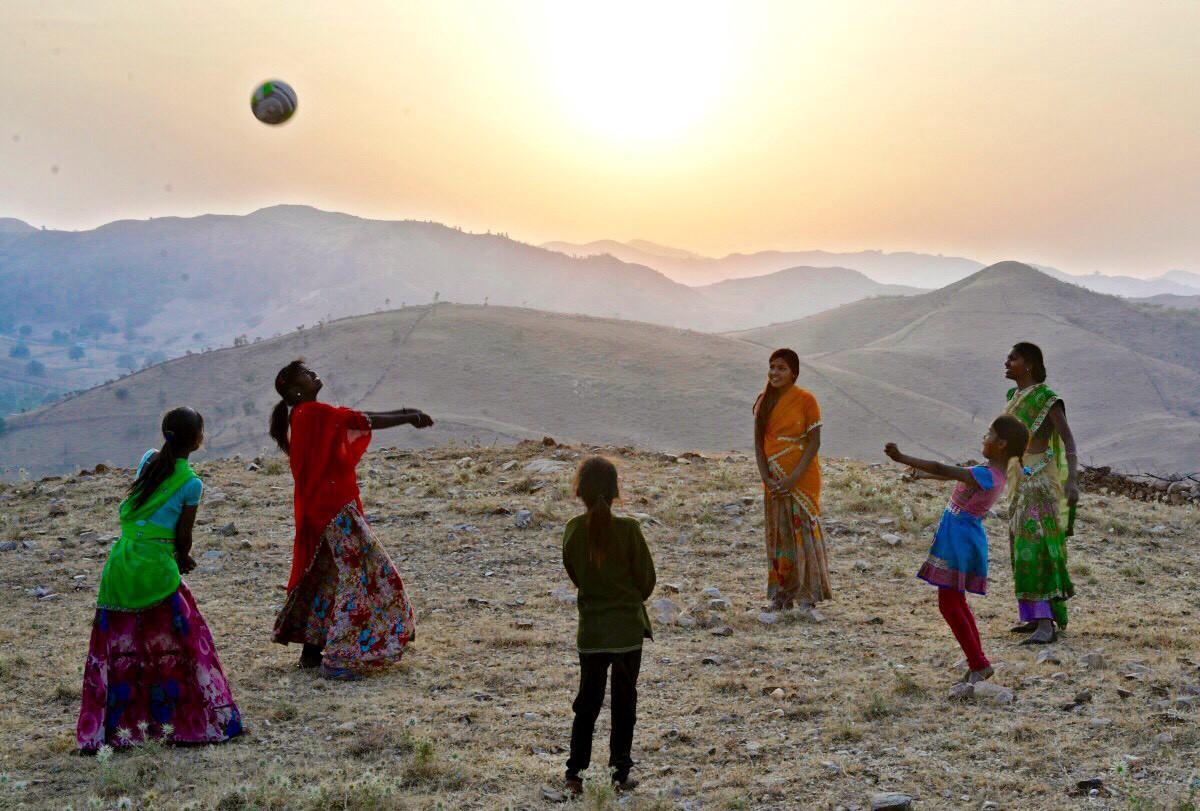 Tribal girls work on their volleyball skills in the village of Kelu Khadra. Photo: Rohit Jain