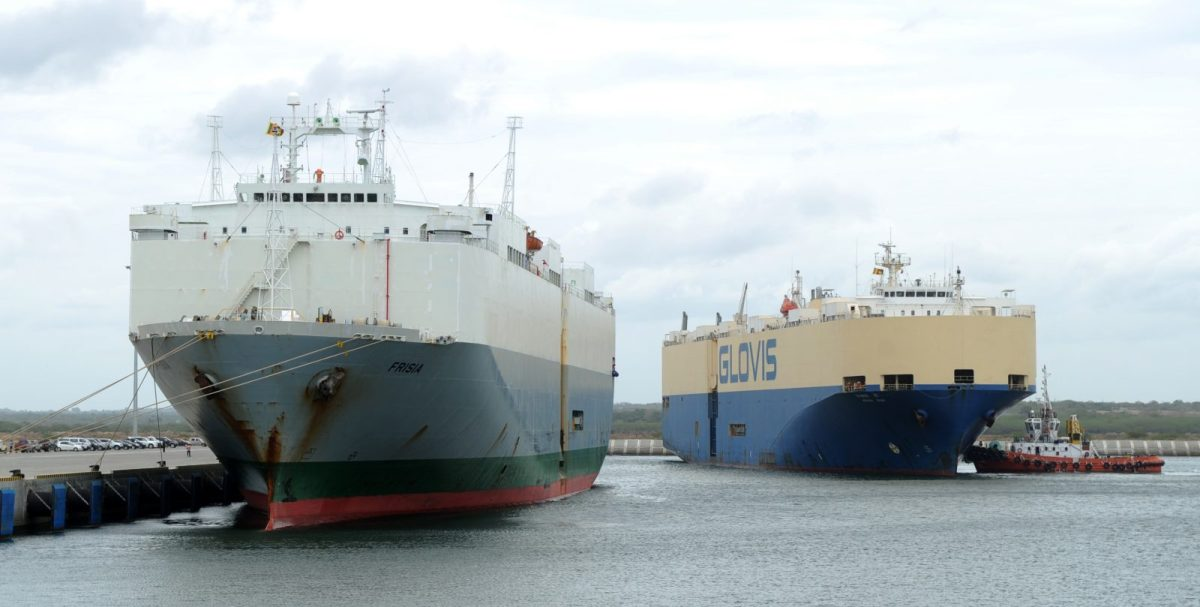 In this file photo taken on June 6, 2012, the Asian Sun car shipping carrier (right) and and carrier Frisia are pictured at the main berth of Sri Lanka's Chinese-built Hambantota Port. Sri Lanka will move its southern naval command to a port leased to a state-run Chinese firm but China will not use it for military purposes, the Sri Lankan Prime Minister's Office said on June 30, 2018. Photo: AFP / Ishara S Kodikara