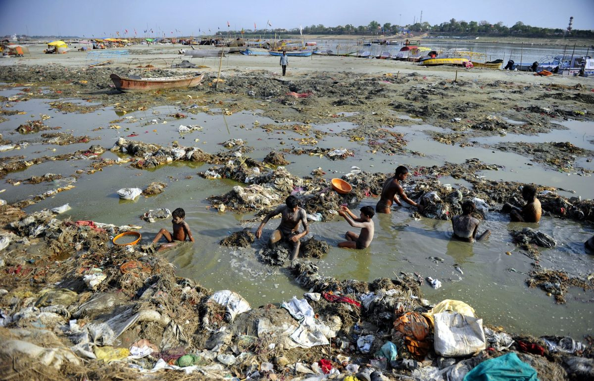 Indian men search for coins and gold in the polluted waters of the Ganga river at Sangam after the Kumbh Mela festival, in Allahabad. Photo: AFP