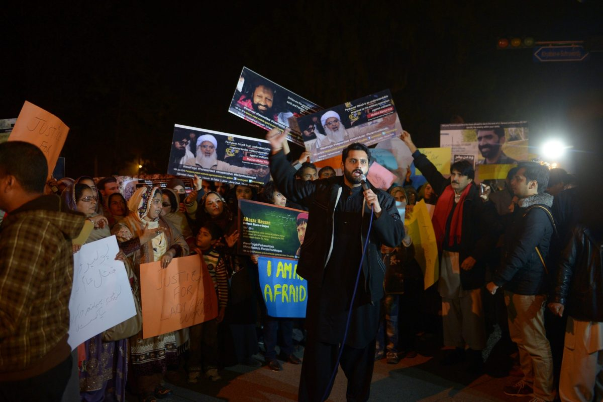Muhammad Jibran Nasir, a young lawyer who has played a key role in organizing demonstrations against the 2014 Taliban school massacre in Peshawar, speaks to civil society activists in Islamabad. Photo: AFP / Farooq Naeem